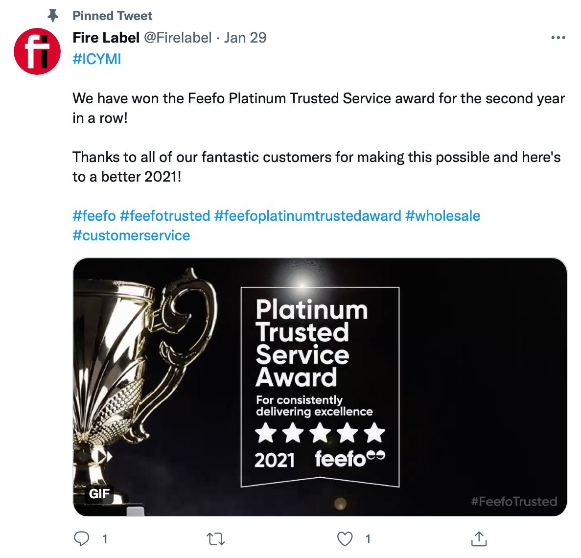 Pinned tweet by @Firelabel shows award and includes hashtags - pinned tweet ideas